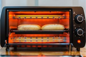 cooking in a black toaster oven cooking